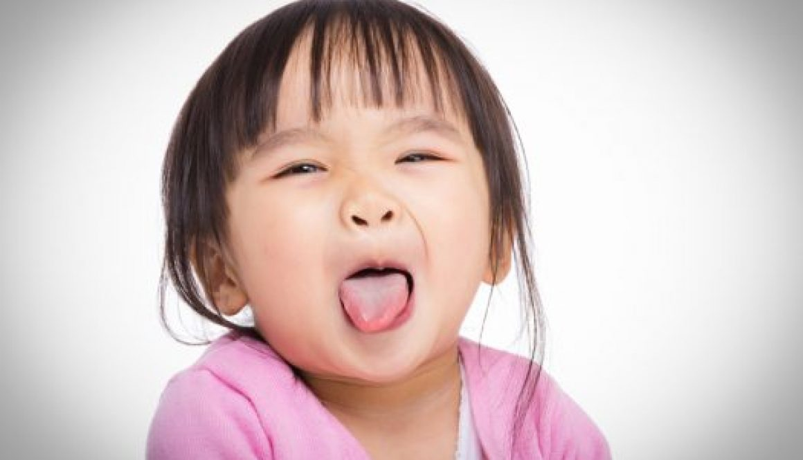 little kids - toddler sticking her tongue out